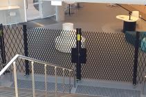 BCA Egress Compliant Extendable Safety Barriers by Trellis Door Co