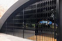 Curved Steel Retractable Security Door from Trellis Door Co