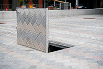 Aluminium Infill Hatches That Blend Into the Pavement by EJ