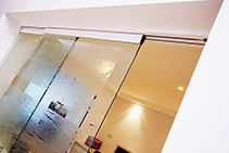 Frameless Glass Partition Doors from Smooth Door Systems