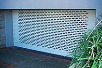 Ventilated Roller Shutters for Garages and Shopfronts from Rollashield