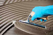Low VOC Deformable Cementitious Adhesive from MAPEI