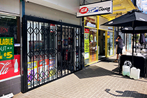 Branded Expandable Security Shutters for IGA by ATDC