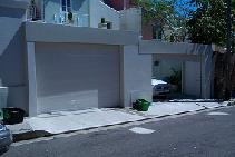 BEasy Custom Security Garage Doors from Rollashield Shutters