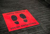 Social Distancing Carpet Tiles from The Nolan Group