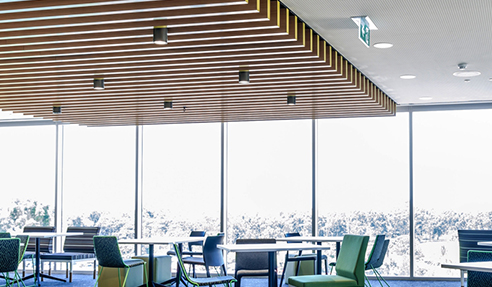 MAXI BEAMS lightweight beams form a ceiling feature in a students lounge