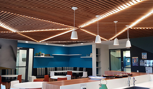 SUPASLAT creative slatted ceiling gives warmth to a staff breakout.