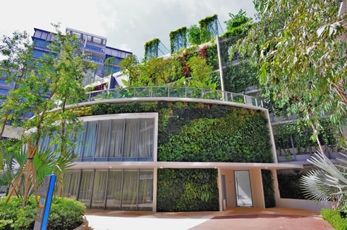green wall facade at residential complex in singapore
