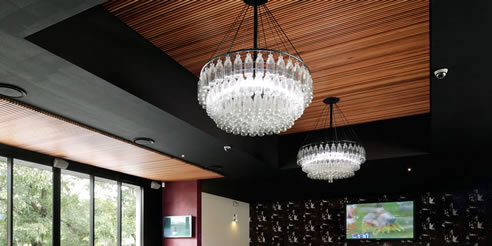 natural timber acoustic ceiling panel feature with chandelier
