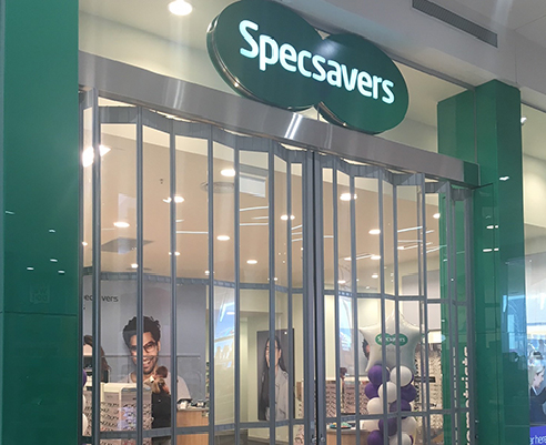 Commercial Concertina Shutters for Specsavers from Trellis Door Co