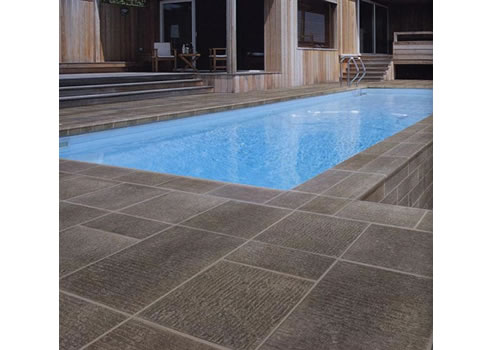 Textured pavers and tiles rocks on hard surface solutions for Pool area flooring