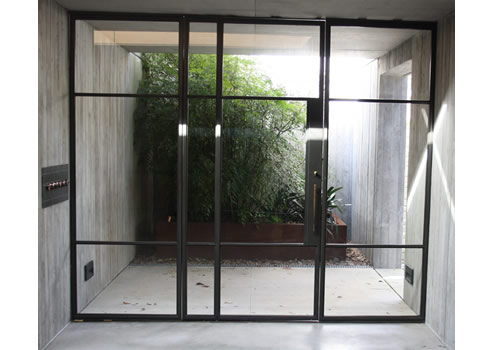 Iron Pivot Doors In Modern Residency Steel Windows And