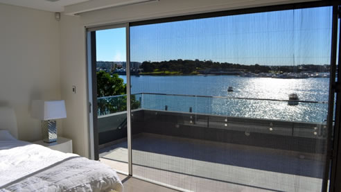 Fly screens for bifold doors sydney from artilux for Retractable screens for bifold doors