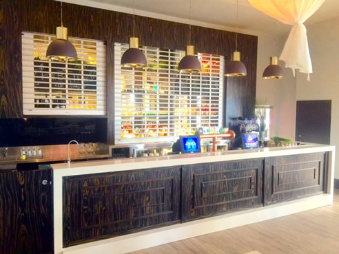 Bar with timber veneer with solid timber stained datto rails