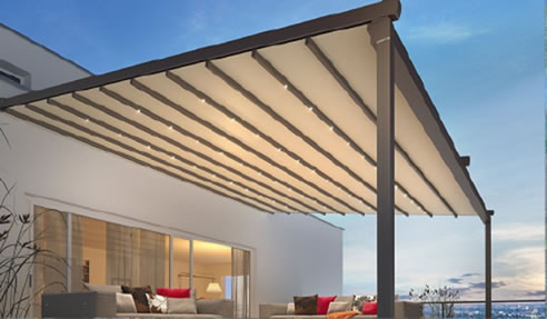 Retractable textile patio roof