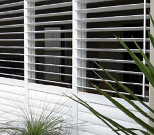 Metal shutters from open shutters interior and exterior Aluminum exterior plantation shutters