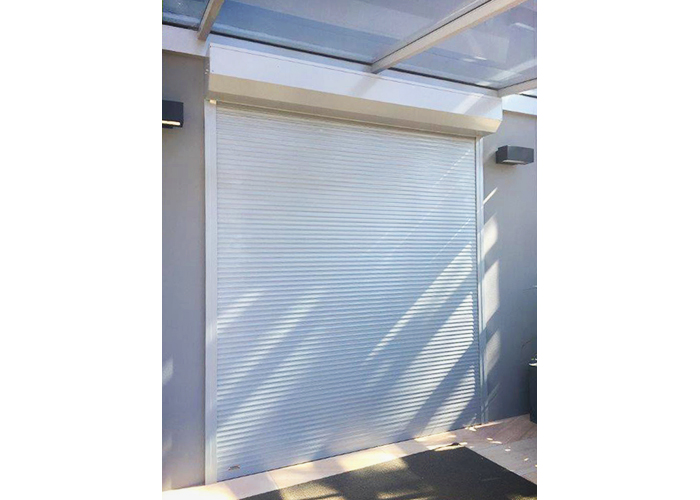 Bespoke Stylish Courtyard Shutters from Rollashield Shutters