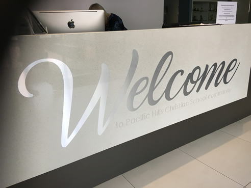 reception desk welcome signage