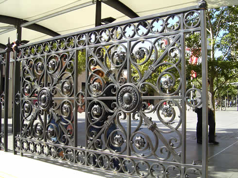 Ironbark blacksmithing heritage re productions of original wrought iron panels meeting another - Wrought iron decorative wall panels ...