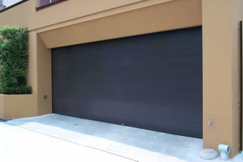 Flat Panel Garage Roller Shutters By Rollashield