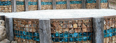 gabion wall with coloured glass landscaping rocks