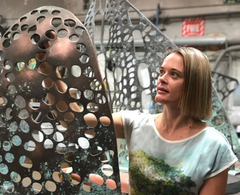 Jade Oakley with Interplay Sculpture