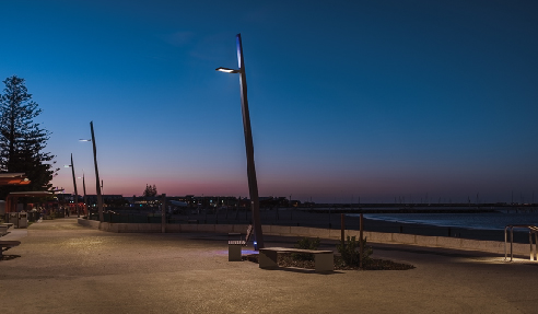 The lighting features a customised illumination system for the new footbridge and lighting poles on the bespoke boardwalk to the promenade.