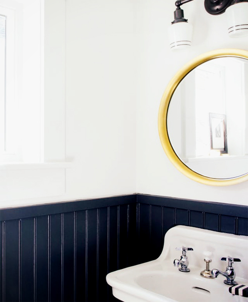 Typically painted in white, you can also add colour to create a more modern interior such as this navy bathroom. Image courtesy of Apartment Therapy.